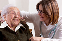 Hospice Care volunteer helping paitent